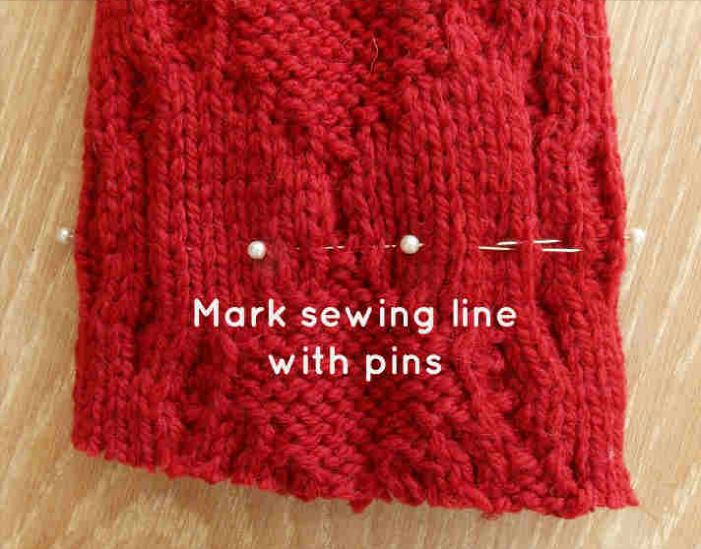 Place pins in the sweater sleeve