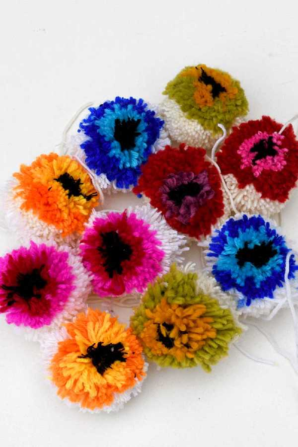 Bright and colorful yarn pom poms