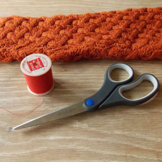Supplies needed to make fingerless gloves from a sleeve