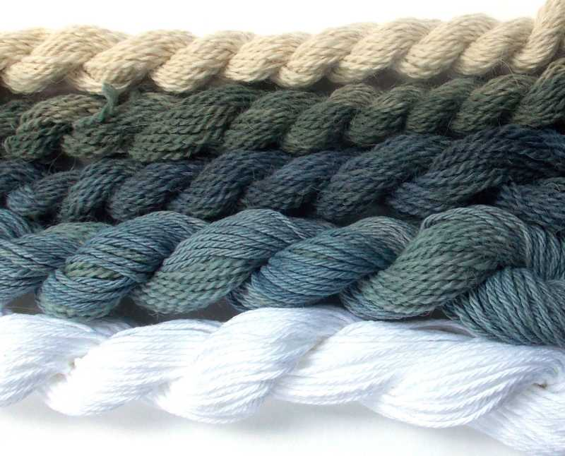 Skeins of yarn dyed with natural black beans