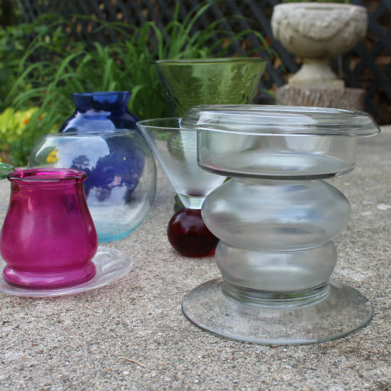 Blue, red and pink glass vases and wine glasses for totem pole