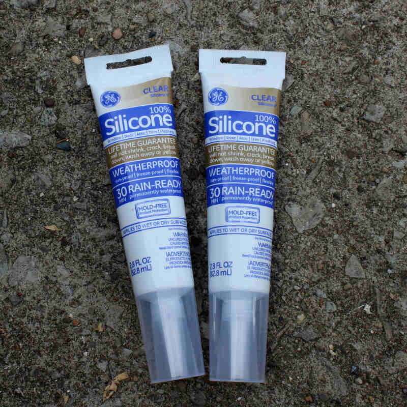 GE Clear Silicone II Caulk to adhere glass pieces