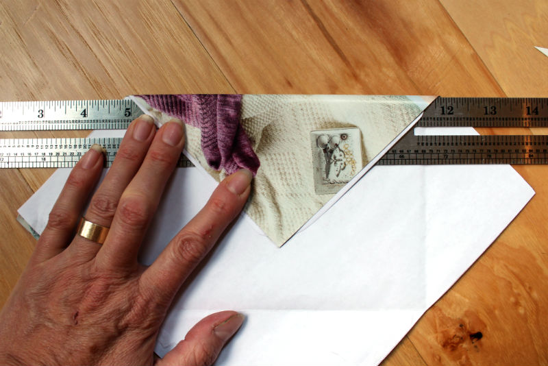 Use the ruler as a guide for the envelope folds